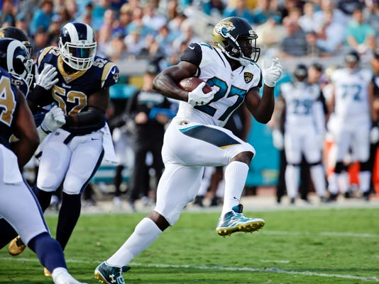 FILE - In this Sunday, Oct. 15, 2017, file photo, Jacksonville Jaguars running back Leonard Fournette, right, runs past Los Angeles Rams linebacker Alec Ogletree (52) on his way to a 75-yard touchdown during the first half of an NFL football game, in Jacksonville, Fla. The Jaguars deactivated Fournette for the Sunday, Nov. 5, game against Cincinnati for violating a team rule. (AP Photo/John Raoux, File)
