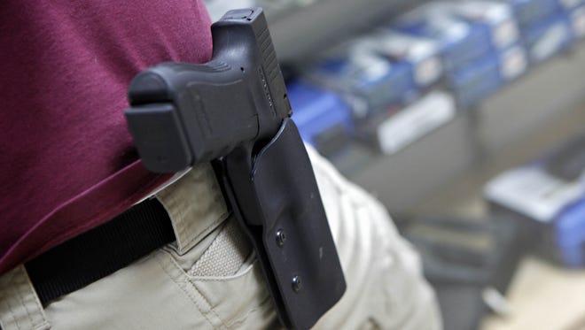 A holstered .45-caliber handgun