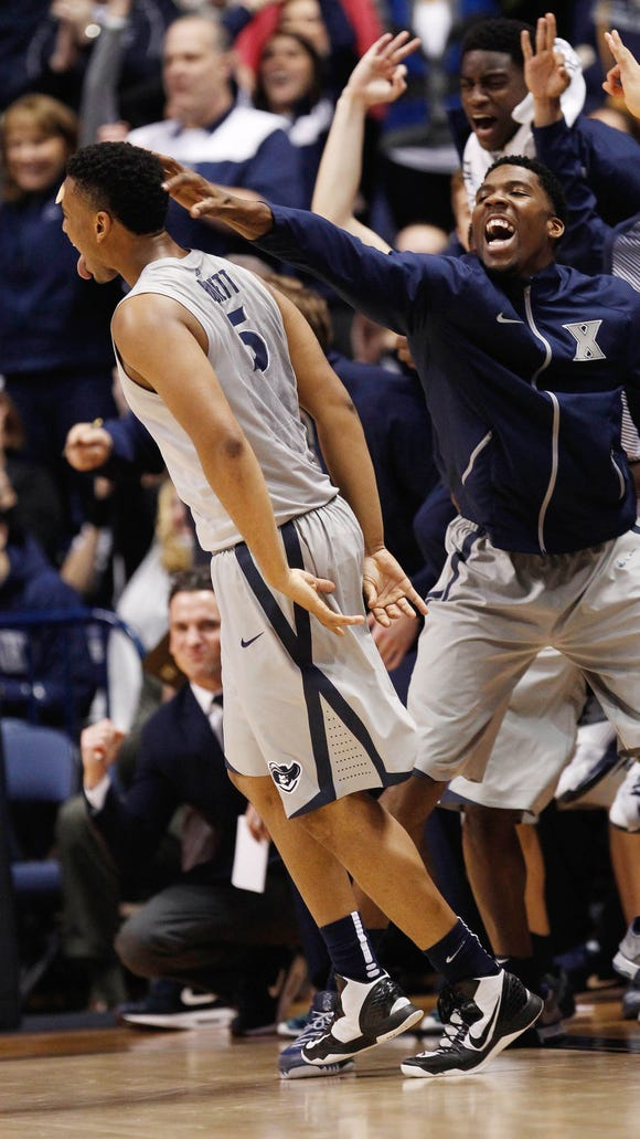 Xavier Musketeers forward Trevon Bluiett (5) reacts with forward Jalen Reynolds (right) after making a three point shot during the second half against the DePaul Blue Demons at the Cintas Center. Xavier won 89-76.