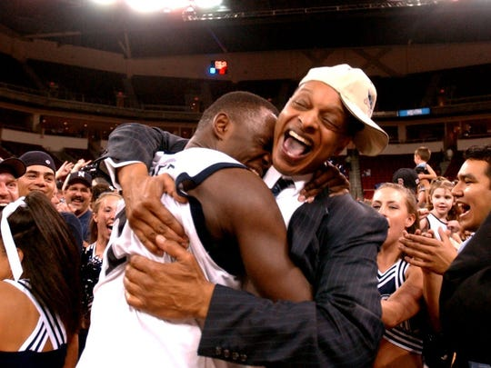 Trent Johnson, right, led Nevada to the Sweet 16 in 2004.