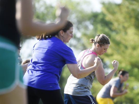 Participants sweat with Cherise Hare and Michelle Thomas