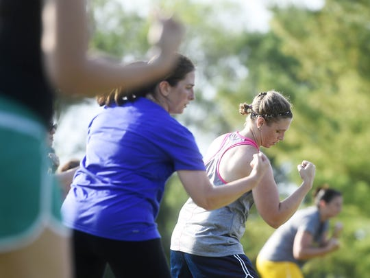 Participants sweat with Cherise Hare and Michelle Thomas from York County YMCA during a Les Mills Bodycombat class for No Sweat in the Park.