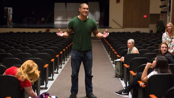 Ikaika Alama-Francis, a former NFL defensive end, speaks with Lely High School CORE Society members in the high school's auditorium in East Naples on Wednesday, Sept. 21, 2016. Alama-Francis, 31, is Drug Free Collier's new community ambassador.