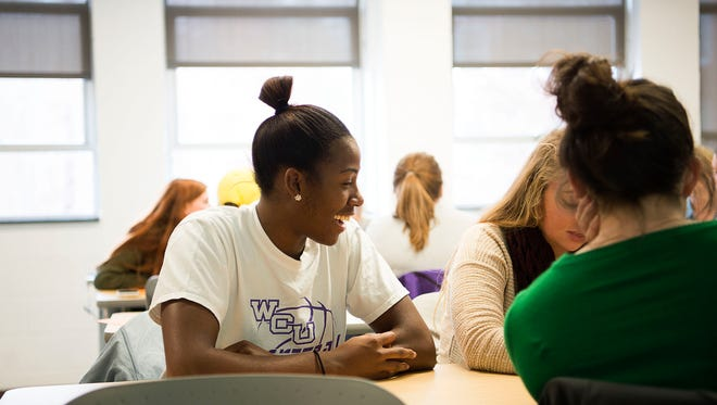 Sherae Bonner laughs with classmates while working on an exercise about graphic novels during her social studies for secondary education class Dec. 6 at Western Carolina University.