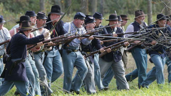 North troops charge with bayonets affixed to their guns during the reenactment of the Road to Franklin Saturday, September 23, 2017 at the Wade House in Greenbush, Wis.