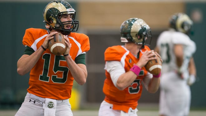 Collin Hill, left, a true freshman from Moore, S.C., and Faton Bauta, a graduate transfer from Georgia, are both competing with Nick Stevens to be CSU's starting quarterback this fall.