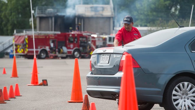 Fort Collins Police Services Officer Spence Alvord supervises a driving course during a police training exercise as Loveland firefighters do some training of their own at the Loveland Fire Training Facility Sept. 20.