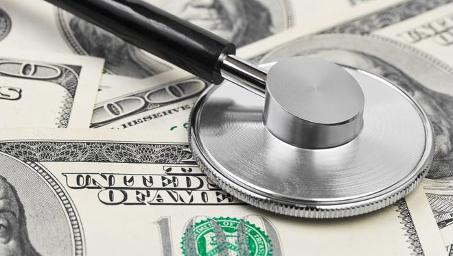 Stethoscope on money background.