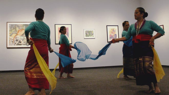 Filipina dancers perform a traditional Muslim scarf dance at the Asian/Pacific Heritage Festival.