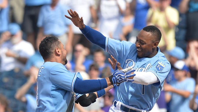 Kansas City Royals second basemen Omar Infante (14) celebrates with teammate Jarrod Dyson (1) after hitting a walk off single for a 5-4 win against the Los Angeles Angels at Kauffman Stadium.