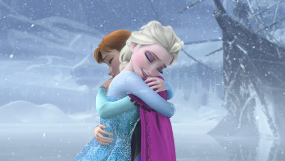 The characters Elsa and Anna embrace in Disney's animated