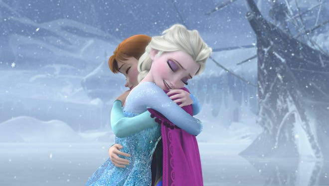 The characters Elsa and Anna embrace in Disney's animated hit 'Frozen.' A stage adaptation of the musical is due on Broadway in 2018.