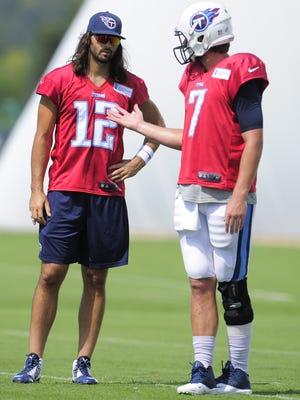 Charlie Whitehurst, left, talks with fellow quarterback Zach Mettenberger during practice last week.