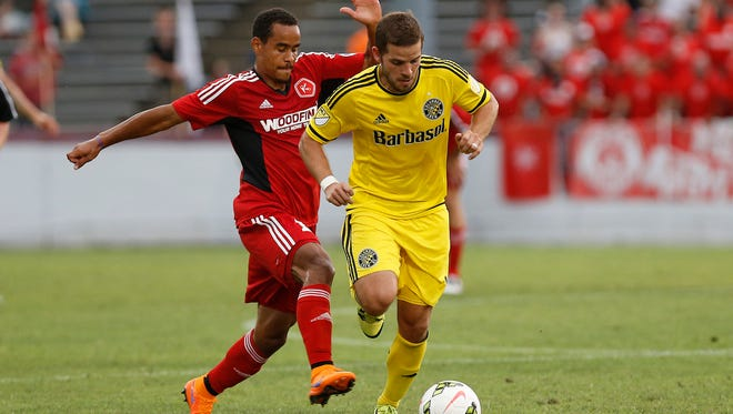 Ben Speas, shown here in yellow playing for Columbus Crew, signed with the Indy Eleven on Tuesday.
