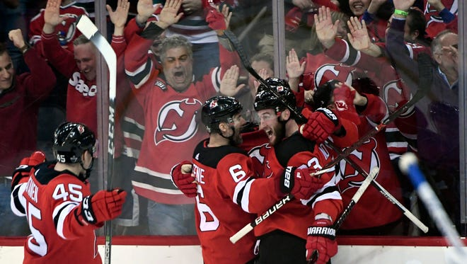 The Devils players and fans celebrate New Jersey Devils right wing Stefan Noesen's goal in the third period, putting them 3-2 over the Lightning. The Devils won, 5-2.