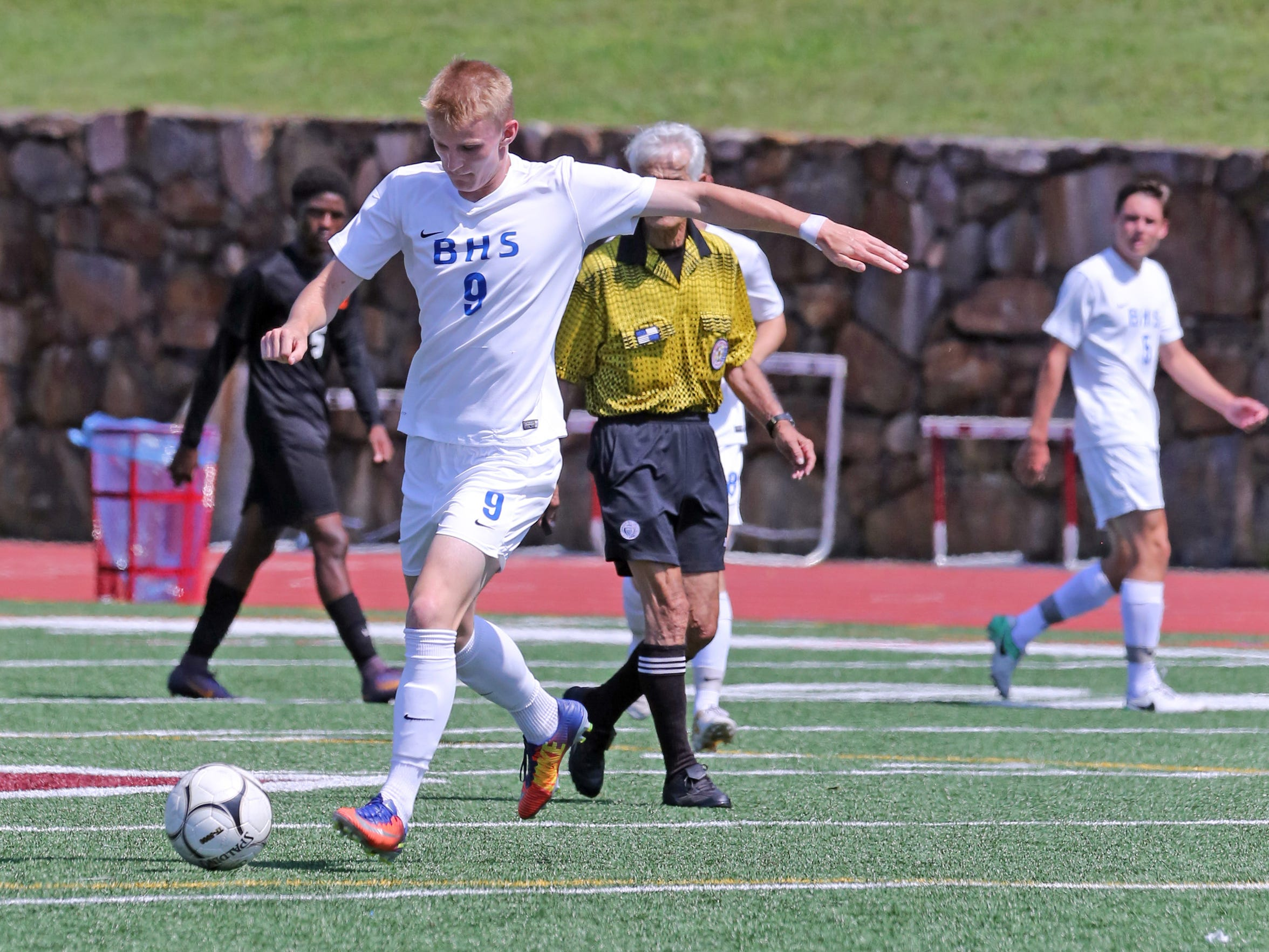 Bronxville's Jeb Burnell kicks the ball in a game against