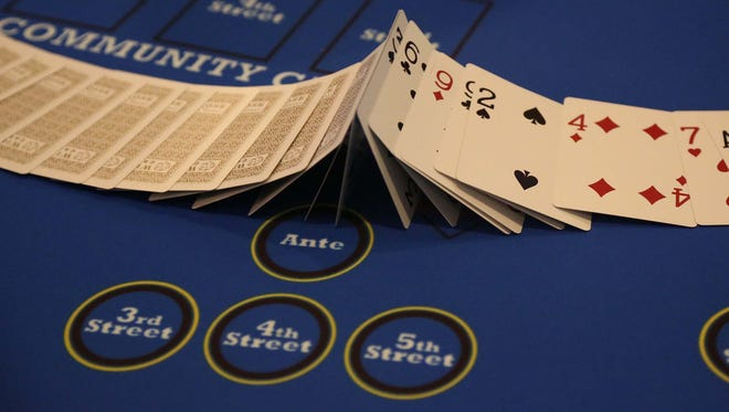 A deck of cards is flipped over at the Wild Rose Casino on Wednesday, July 29, 2015 in Jefferson.