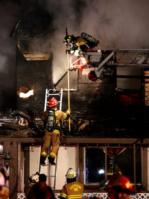 Firefighters work to extinguish a blaze at Casa Loma Bar in Cleves Thursday night. No one was injured.