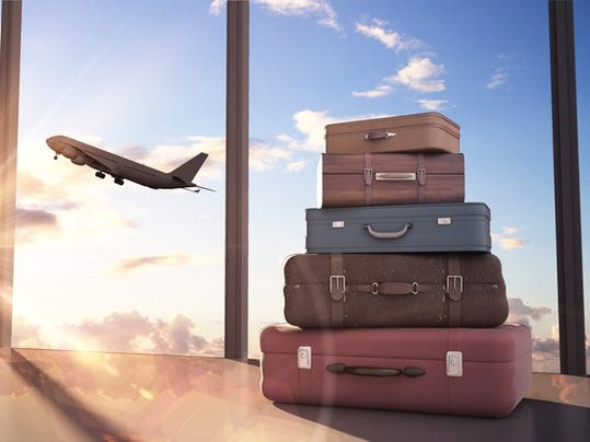 online-travel-industry-airplane-taking-off-luggage-in-pile_large.jpg
