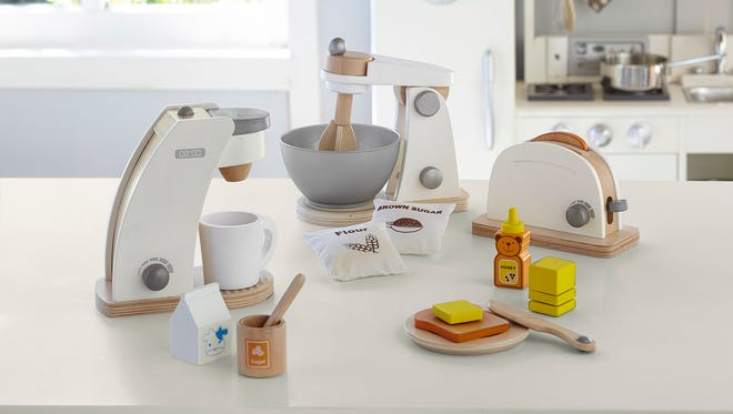 Interactive wooden kitchen appliances available at Pottery Barn Kids.