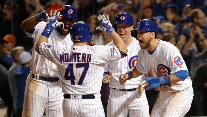 Miguel Montero gets a hero's welcome at home plate after his decisive grand slam in Game 1.