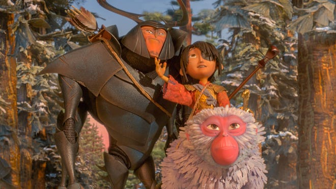 Beetle (voiced by Matthew McConaughey), Kubo (Art Parkinson) and Monkey (Charlize Theron) head off an epic quest in 'Kubo and the Two Strings.'