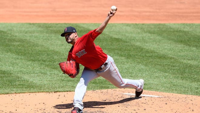 Red Sox starter Martin Perez delivers last week at Fenway Park.