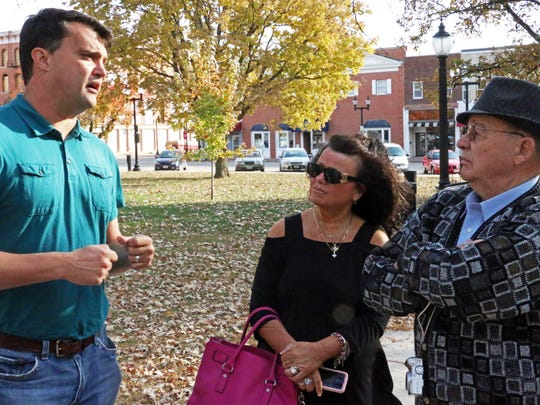 Luke Robinson of Robinson Iron in Alabama, left, speaks to Mary Hassenfritz, niece of late Mount Pleasant Mayor Edd King, and Wayne King, the late mayor's brother. A memorial fountain to the late mayor was dismantled in downtown Mount Pleasant on Wednesday, Oct. 21, 2015. The fountain will be refurbished over the winter in Alabama.