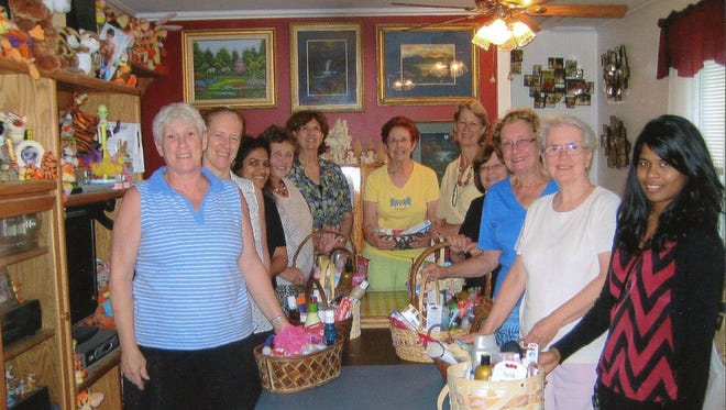 A group of volunteers in Poughkeepsie led by Cathy Temple recently delivered 39 baskets filled with personal care items for women entering the Grace Smith House battered women's shelter.