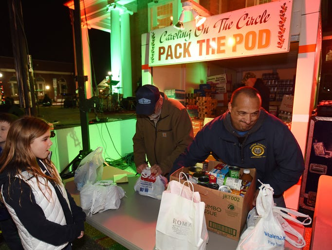 """Volunteers help """"Pack the Pod"""" at the annual Caroling"""