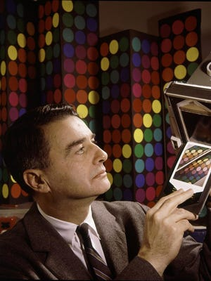 Portrait of American scientist, inventor, and businessman Edwin Land (1909 - 1991), president and co-founder of the Polaroid Corporation as he demonstrates his companies '60-second film,' 1963. (Photo by Fritz Goro/The LIFE Picture Collection/Getty Images)