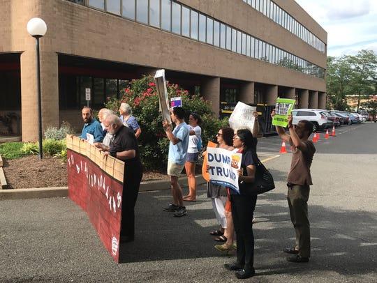 Activists protest Rep. Josh Gottheimer's recent vote