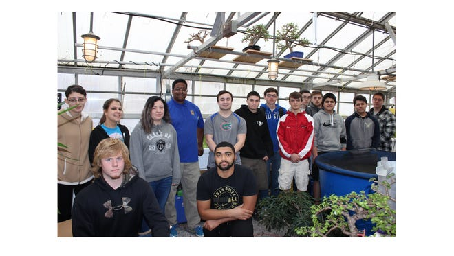 Gary Nelson (back row, fourth from left), a horticulture teacher at Delsea Regional High School who was awarded the 2016 Honorary State Future Farmers of America Degree in recognition of his significant contributions to the FFA and to school-based agriculture, food and natural resources education in New Jersey, is shown with his students.