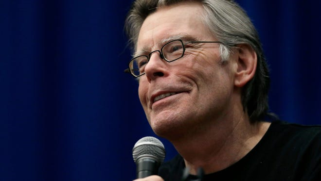 """In this Dec. 7, 2012 file photo, novelist Stephen King speaks to creative writing students at the University of Massachusetts-Lowell in Lowell, Mass. King's time-travel novel about the Kennedy assassination is being adapted as a small-screen miniseries. Streaming service Hulu said Monday, Sept. 22, 2014, that the nine-hour series, titled """"11/22/63"""" after King's book, includes the author and J.J. Abrams as executive producers. (AP Photo/Elise Amendola, file)"""