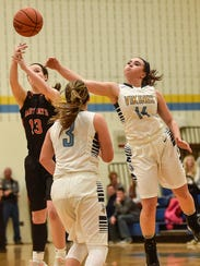 River Valley's Morgan Lott swats away a pass to North