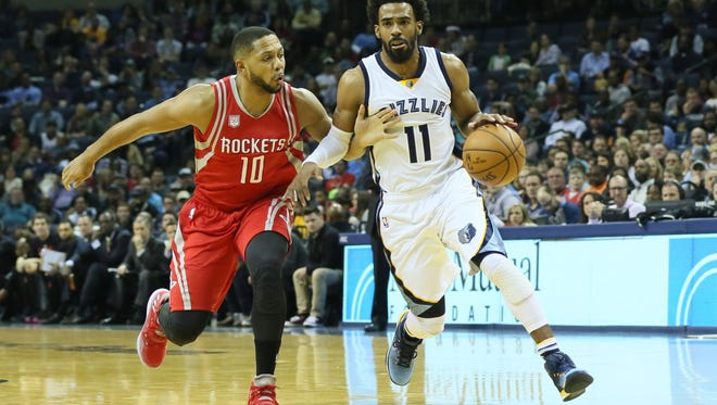 Memphis Grizzlies guard Mike Conley (11) drives against Houston Rockets guard Eric Gordon (10) during the first quarter at FedExForum.