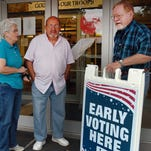 Voters watch a voting booth tutorial prior to casting their vote during early voting Saturday at the St. Landry Parish Courthouse.
