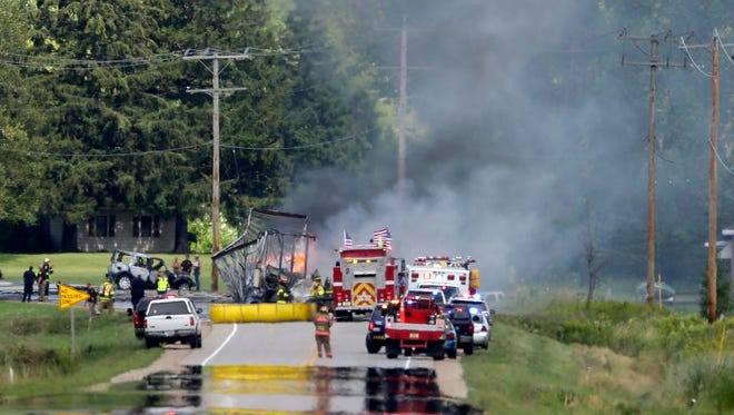 First responders work to put out a semi truck fire on Highway 47 North of Black Creek Wednesday, Aug. 19, 2015, in Black Creek.