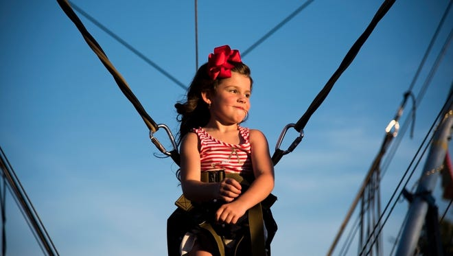 Emma Wetzstein, 6, enjoys the moment on a bouncy ride at the Bullitt County fair.  Emma is from Radcliff, Ky.
