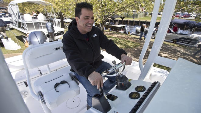 Joseph Minervini of Point Pleasant, looks over a 2016 Sea Hunt Ultra 211. Huddy Park in downtown Toms River is the location for the seventh annual In-Water Boat Show in Toms River.