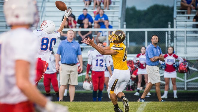 Monroe Central's Nick Mitchell catches a pass against Union County during their game at Monroe Central High School Friday, Aug. 26, 2016.