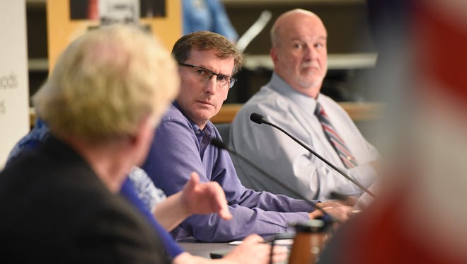 St. Cloud City Council members Jeff Johnson, left, and Jeff Goerger take part in the City Council meeting Monday, Oct. 23, in St. Cloud.