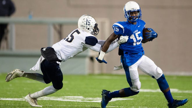 Paul Bryant corner back Jemarcus Burrell (15) tackles Sidney Lanier player Jacory Merritt (15) during the AHSAA playoff football game between Sidney Lanier and Paul Bryant on Thursday, Nov. 9, 2017, in Montgomery, Ala.