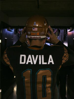 Rattlers' Nick Davila puts on his helmet before entering the field against the Kiss at US Airways Center in Phoenix, AZ on July 25, 2015.