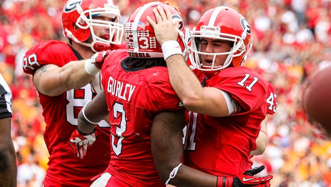 (File) Former Georgia Bulldogs running back Todd Gurley (3) and quarterback Aaron Murray (11) have bonded even more the past year after having the shared experience of recovering from ACL injuries.