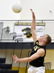 Red Lion's Dillon Hildebrand serves the ball in the