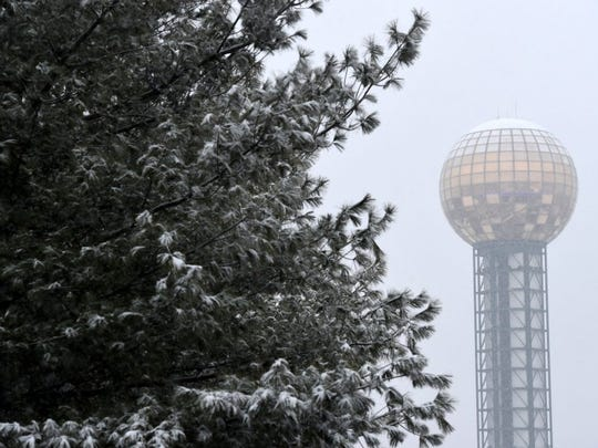 The Sunsphere is covered during snowfall in downtown Knoxville Friday, Feb. 12, 2016.