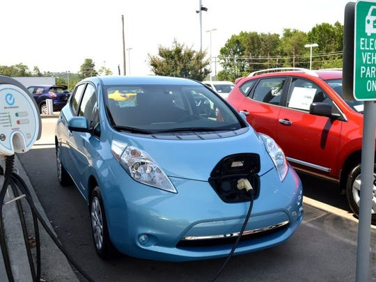A Nissan Leaf electric car gets its battery charged at Twin City Nissan in Alcoa.