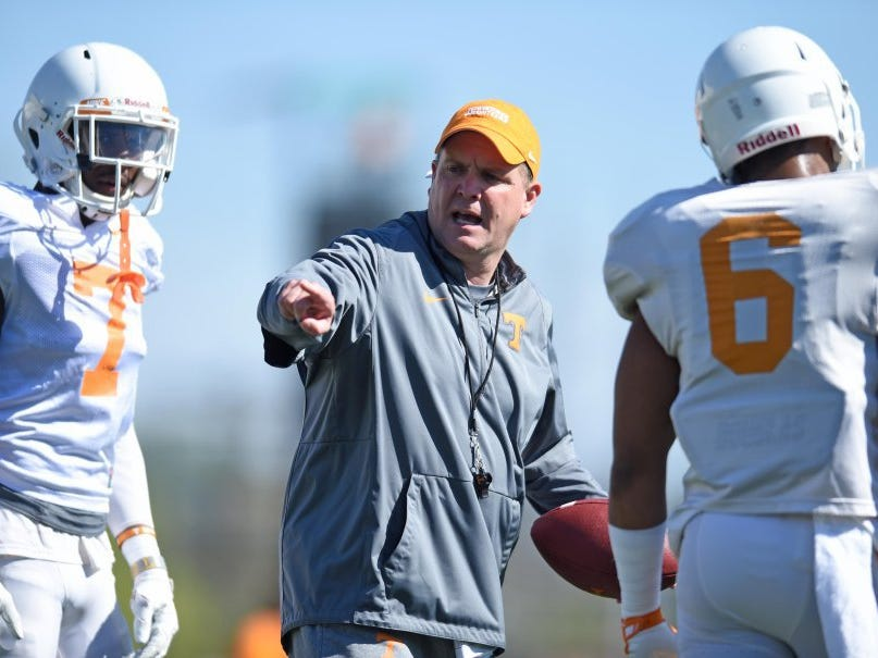 Tennessee defensive coordinator Bob Shoop, center, instructs Vols safeties Rashaan Gaulden (7) and Todd Kelly Jr. (6) during spring practice on March 29, 2016.