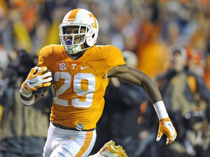 Tennessee defensive back Evan Berry (29) returns a kickoff for touchdown during the first half at Neyland Stadium in Knoxville, Tenn. on Saturday, Oct. 3, 2015. (AMY SMOTHERMAN BURGESS/NEWS SENTINEL)